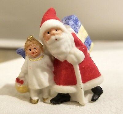 Miniature Bisque Santa accompanying Snow Angel.   Early 1920s German Figure
