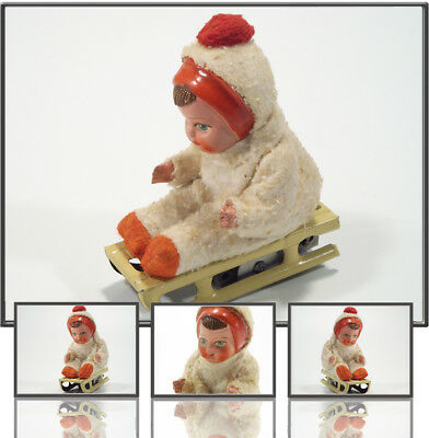 TOPTINTOY: US ZONE GERMANY TIN WIND UP BABY ON SLED BY HAMMERER & KÜLWEIN, 1950s