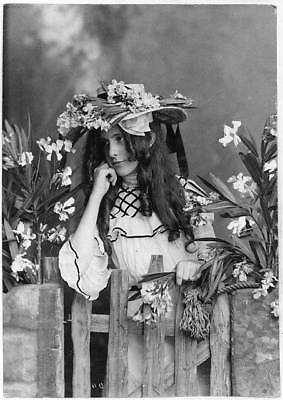 Photo:Girl,Flowers on hat,gate,c1902,Glamour