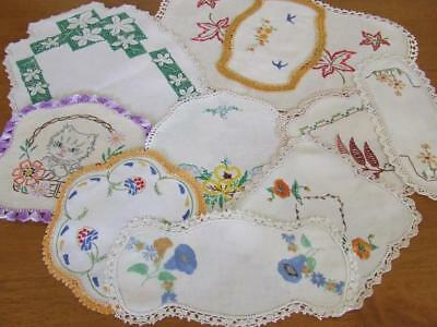 An Assortment of Ten Lovely Vintage Hand Embroidered Centres & Doilies