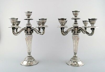 A pair of Spanish candelabra in silver, early 20th century.