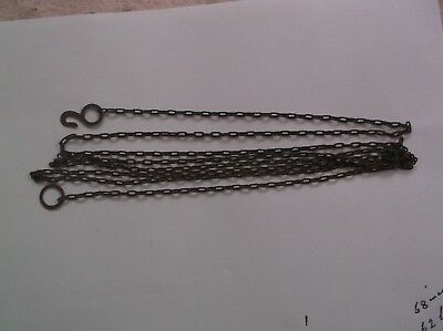 A STEEL CHAIN FROM AN OLD CUCKOO CLOCK 68 INCH LONG 62 LINCS TO THE FT  ref C9
