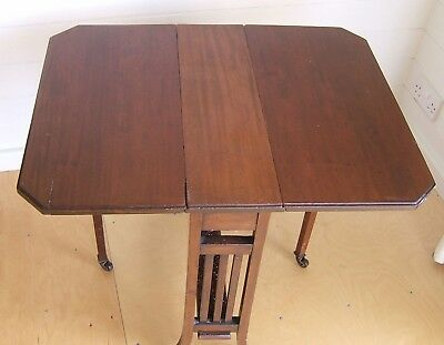 Stylish small antique mahogany Sutherland table with two leaves