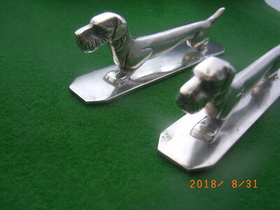 1930's. Wisekmann, Belgium. 2 Dog Knife Rests. Silver Plated. Art Deco