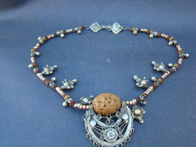 antique chinese hand carved rugby pearl with white metal necklace