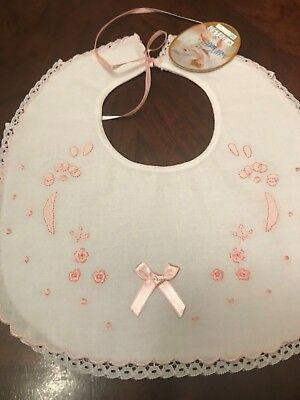 Beautiful Round White Bib with Pink Embroidery