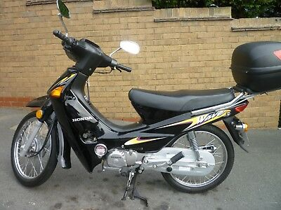 Honda Wave 97cc 1400 miles only.  Almost indistinguishable from new. No reserve.