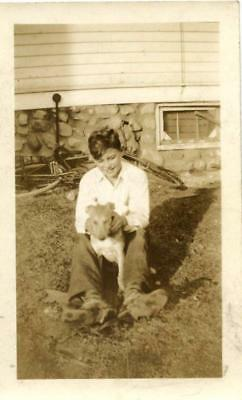 Antique photo of boy with dog and bike
