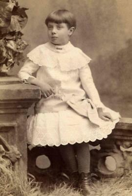 1800s Antique Cabinet photo of child in white dress with boots leggings