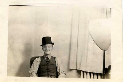 Vintage photo of man with top hat and light