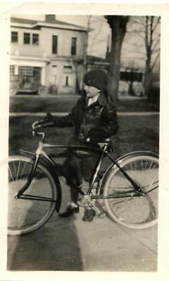 1920s boy in knickers with his bicycle snapshot