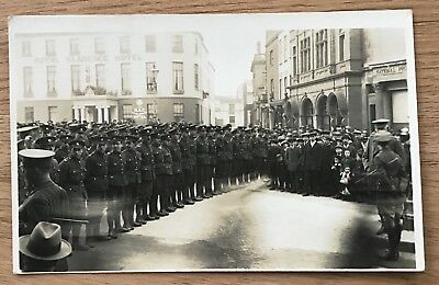 A Vintage Sepia Postcard of World War One Soldiers on Parade in Exeter - Devon