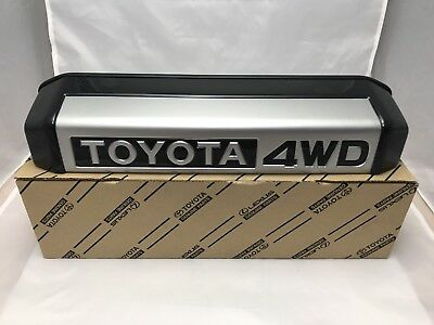 Genuine OEM Toyota Land Cruiser 70 series rear license plate lamp cover