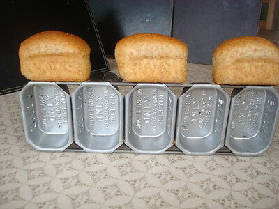 5 mini  hovis tins never been used