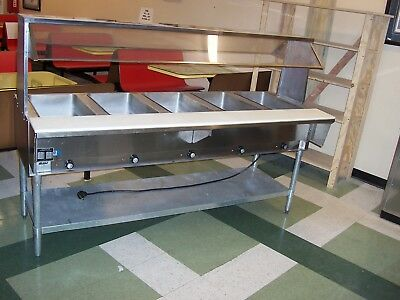 Salad bar with sneeze guard, used but in good condition.