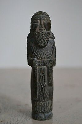 Statue symbolizing the chief priest of the temple of Amun Carved on stone .rare