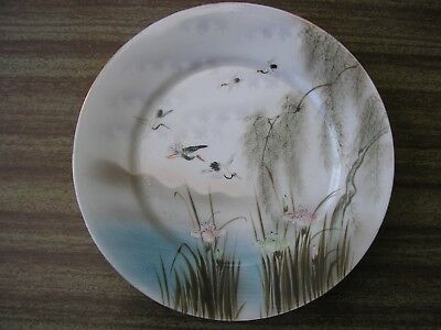 Antique Japanese plate hand painted with flying crane birds, signed by artist