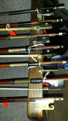 Old violin bows (7) stamped and 1  experimental bow w/silver head