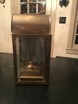 antique maritime nautical brass lantern meant to be hung. But works on table