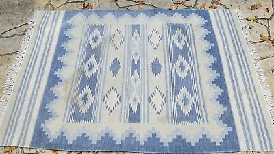 Old, early Chimayo rug in unique blue and cream colors in great pattern, 53 x 83