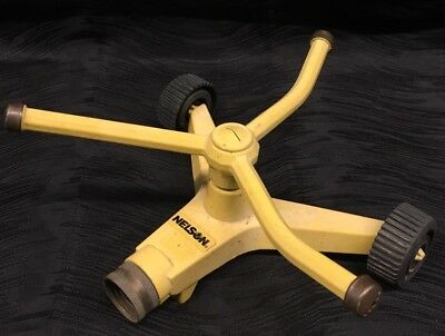 Vintage Nelson Poppy Lawn Sprinkler yellow metal with wheels