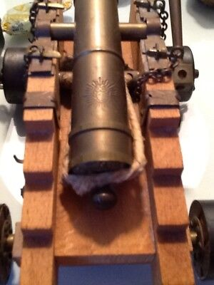 Vintage 4 1/2 inch length brass cannon barrel mounted on Wooden Carriage.