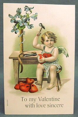 Antique Postcard Valentines Day To My Love Cupid Hammering Ironwork Hearts