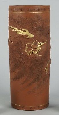 A JAPANESE TOKONAME RED WARE CYLINDRICAL VASE,DECORATED WITH LONG DRAGONS.Meiji.