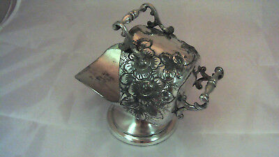 Very ornate repousse silver plated sugar scuttle