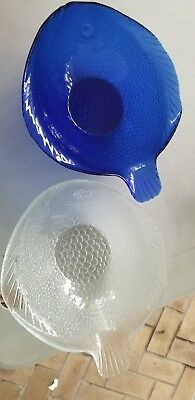 2 Glass fish shaped bowl. One clear, one blue.