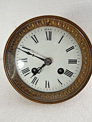 "Antique French mantel clock movement fits a 4 1/4"" opening"