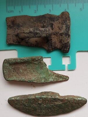 metal detecting find 3 bronze age axe head pieces