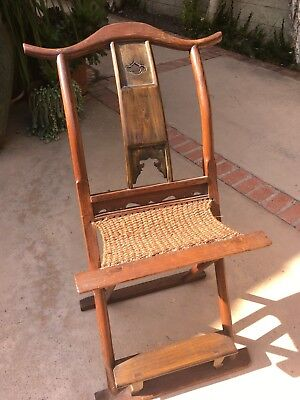 Early 20th century Chinese antique wood folding chair. Excellent condition.