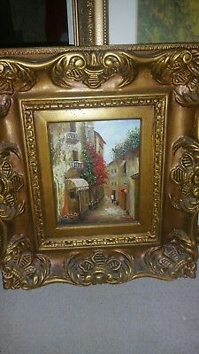 oil painting in ornate frame