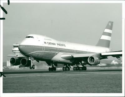 First class flight with Cathay Pacific Boeing 747 - Vintage photo