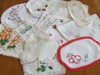 An Assortment of Ten Vintage Hand Embroidered Centres and Doilies