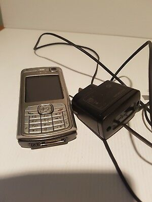 Retro mobile phone Nokia n70 with charger not working for parts