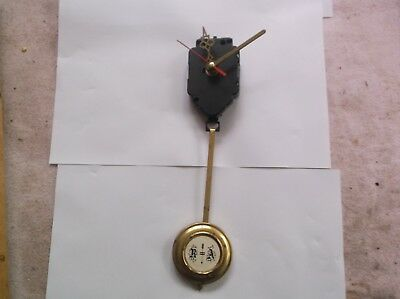 A  Mechanism From A Battery Operated  Wall Clock   With Pendulum