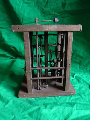 Antique wooden wall clock movement marked G. Linder