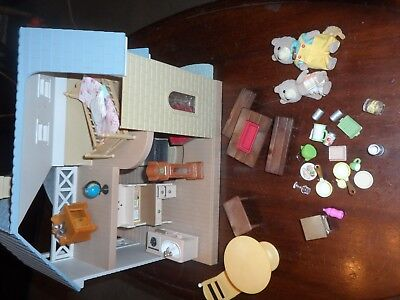 Sylvanian Families Bluebell Cottage With Some Furniture And Figures.
