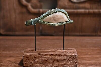 An Antique Egyptian Bronze & Alabaster Eye From A Mummy's Wood Inner Coffin