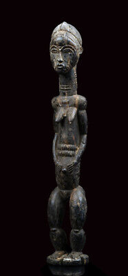 A slender female Baule sculpture