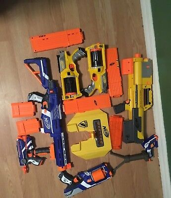 Assorted Used Nerf Gun Lot, Includes Darts, Clips And other Accessories