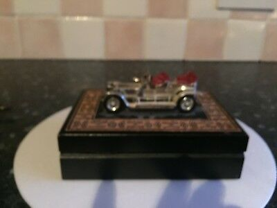 Wooden box with a car on the top