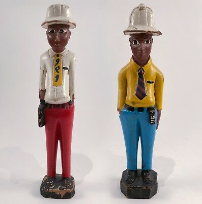 Pair of hand carved wooden African figurines painted standing male figures