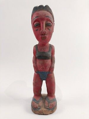 Hand carved wooden African figurine painted seated female figure