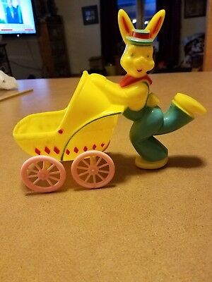 Easter Bunny pushing baby stroller candy container 1950s plastic vintage rabbit