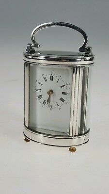 Chrome & Bevelled Glass Oval Carriage Clock