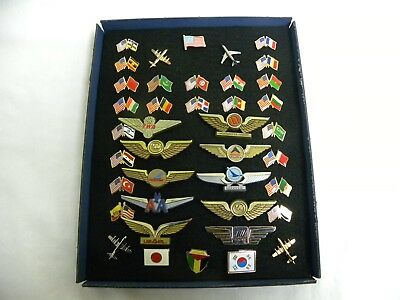 US/ InternationalLapel flags (25), US Airline Wings (10), Airline pins (4)