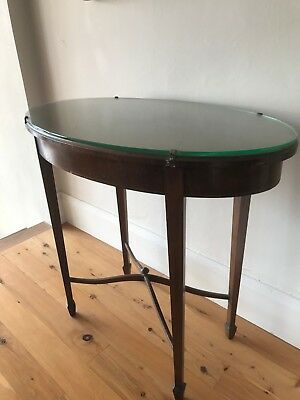 Reproduction occasional oval table, glass topped